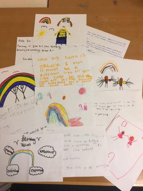 Children at Fairway Primary School show support to elderly residents