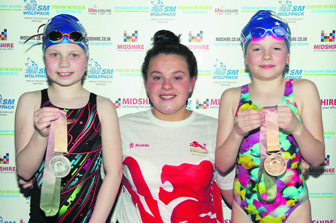 HOLLY BRINGS HOME DOUBLE MEDAL HAUL
